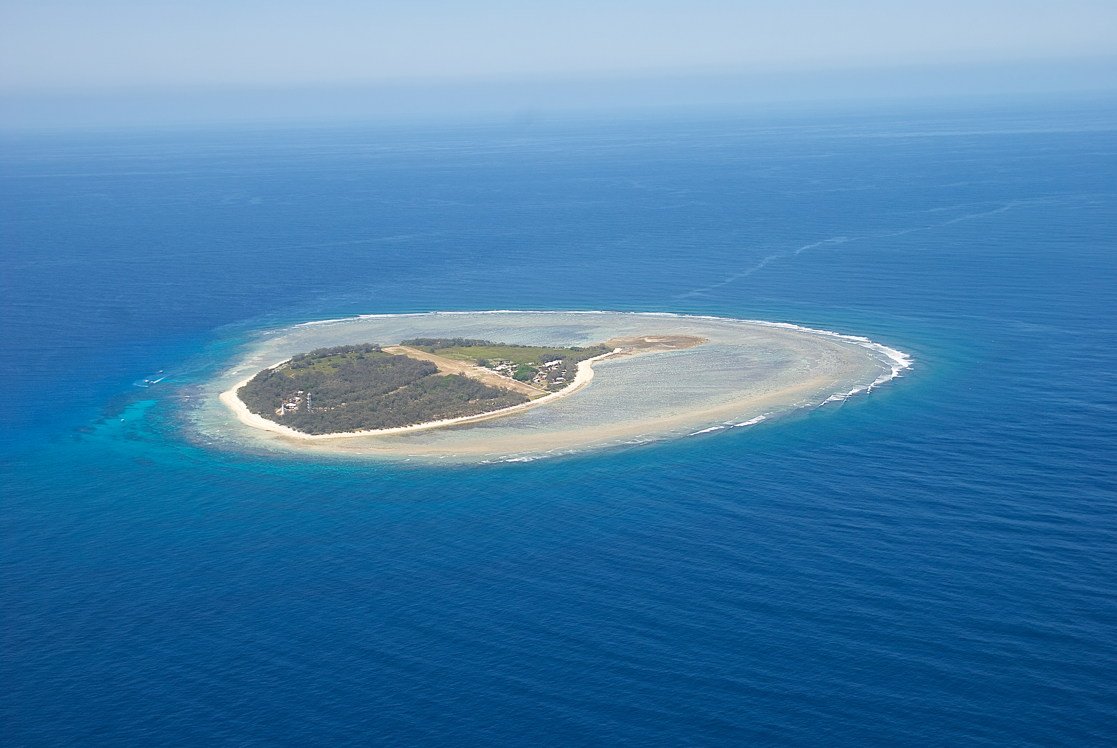 Lady Elliot Island, photo taken by us through windows of the plane. A beautiful clear day. The lagoon is clearly visible