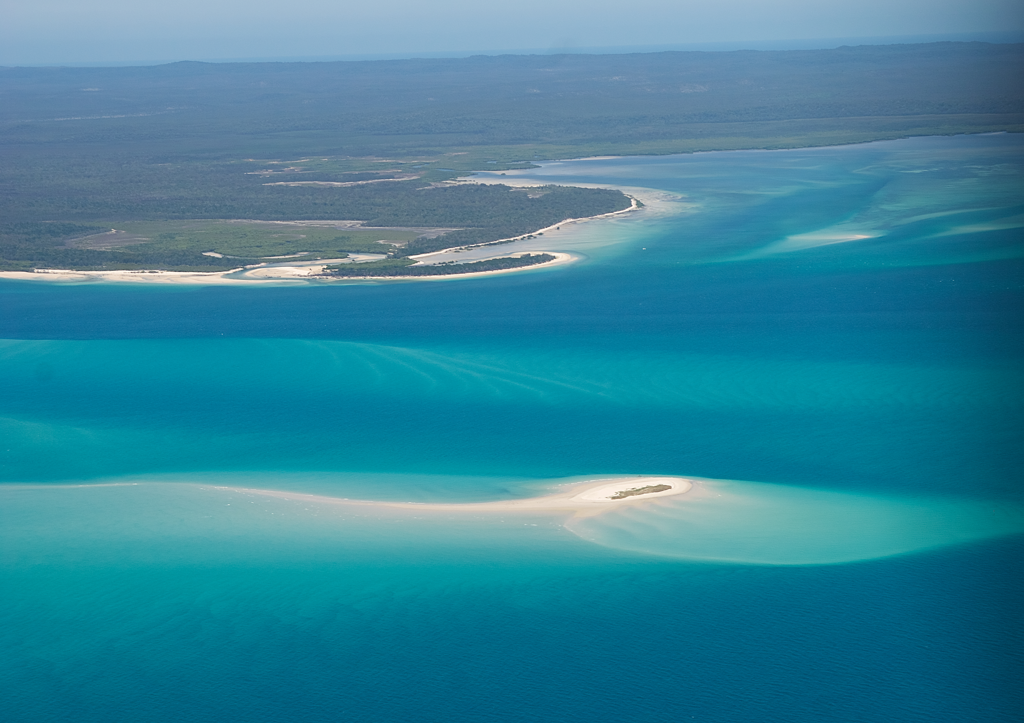 Looking back southward as we past by Fraser Island we also see small islands and sand banks and blue waters