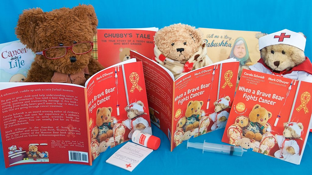 Three of the bears in the book read their copies. You can see Dr Caddy wearing her specs, patient Stiches in his dressing gown, and Nurse Bree.